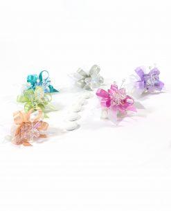 bomboniere tubicino confezionato con farfalle in cristallo colorate tufano