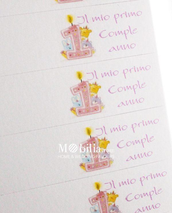 bigliettini con candela rosa e scritta il mio primo compleanno