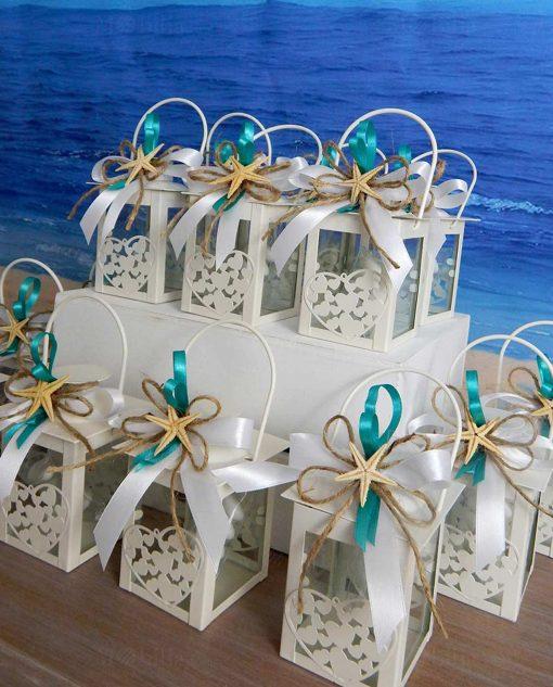 bomboniera lanterna cuore con nastri bianchi e tiffany e stella marina