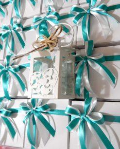 bomboniera lanterna metallo cuore confezionata con nastro tiffany bianco e stella marina