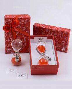 bomboniera clessidra vetro con sabbia rossa e gufo in argento