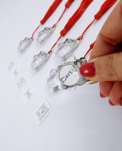 lente di ingrandimento a forma di borsa dottore argento con nappina rossa