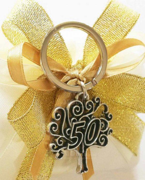 portachiavi albero della vita con 50 su sacchettino bianco con fiocchi oro
