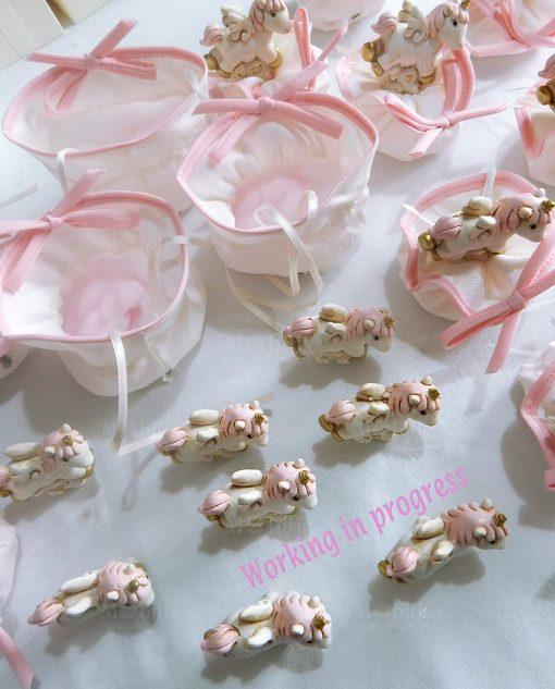 bomboniera unicorno rosa con sacchetto rosa e bianco