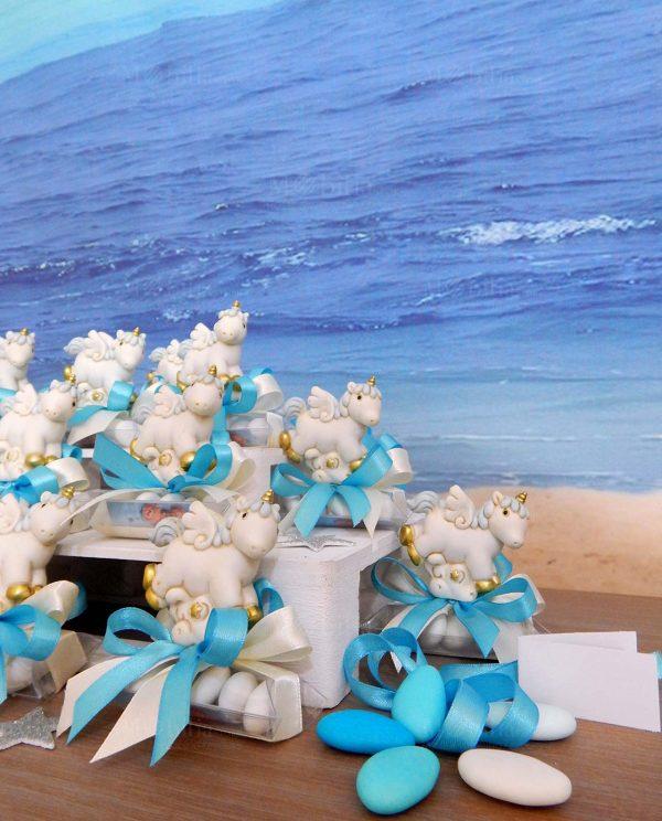 bomboniere unicorno resina su tubicino con fiocchi azzurri
