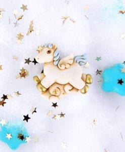 calamita cavalluccio azzurro con dettagli oro