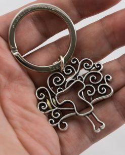 portachiavi albero della vita con croce tau argento tabor su mano