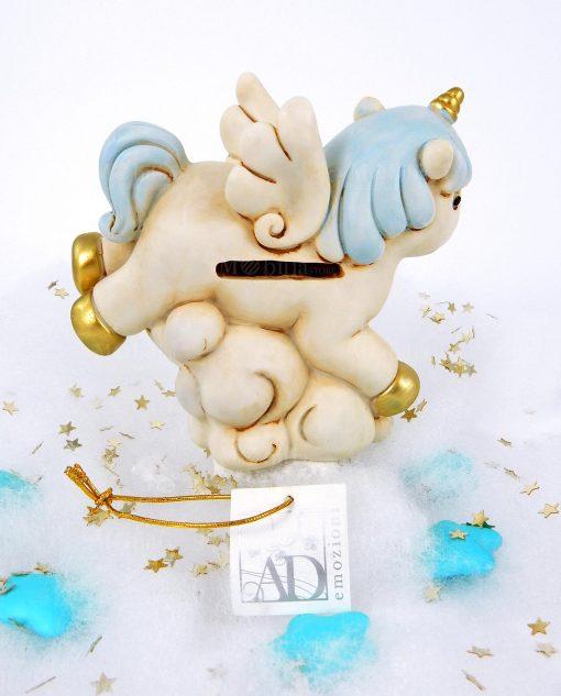 salvadanaio a forma di unicorno azzurro con dettagli oro