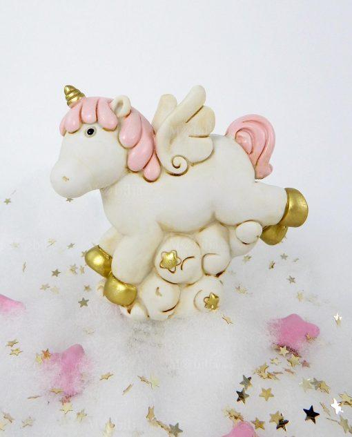 salvadanaio unicorno rosa e oro su nuvola