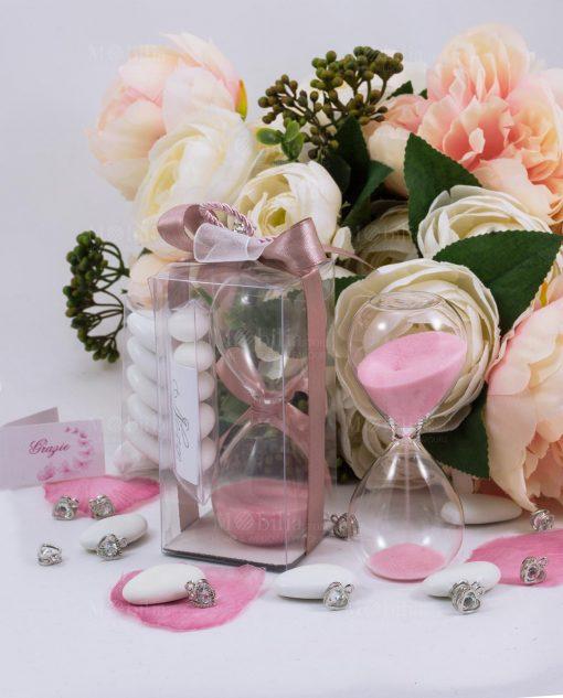 bomboniera clessidra vetro sabbia rosa con scatola trasparente ciondolo cuore e nastri rosa