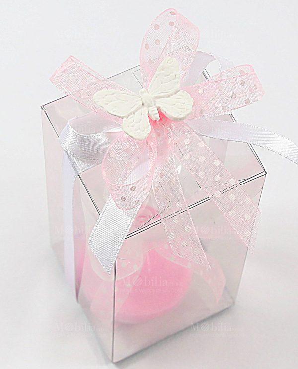 bomboniera clessidra sabbia rosa confezionata con fiocchi e farfalla gesso