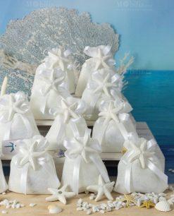 bomboniera magnete stella marina opaca su sacchettino bianco con fiocco a 4