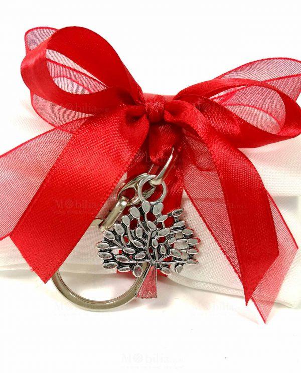 sacchettino bustina con nastri rossi e portachiavi metallo albero della vita