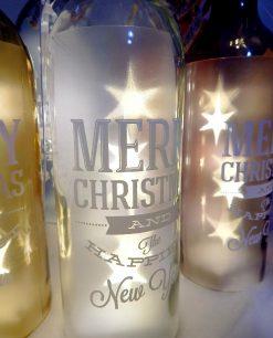 bottiglie natalizie con luci