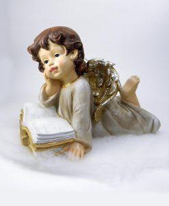 angioletto sdraiato con libro