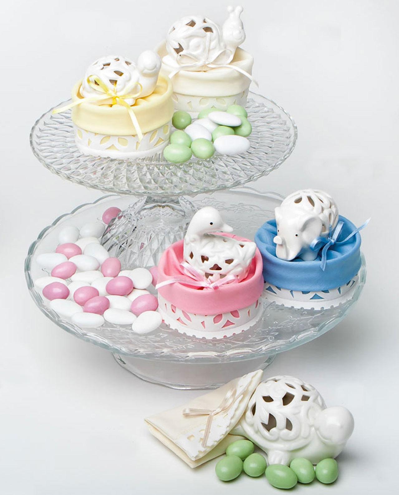 bomboniere battesimo animali in ceramica su sacchetto colorato
