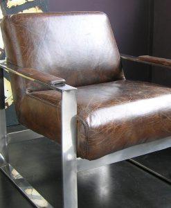 poltrona pelle vintage con profili acciaio