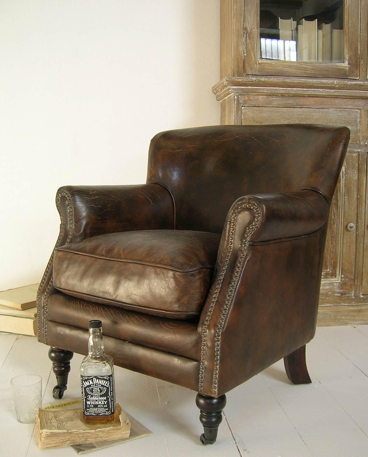 poltrona marrone pelle vintage con rotelle mobilia store