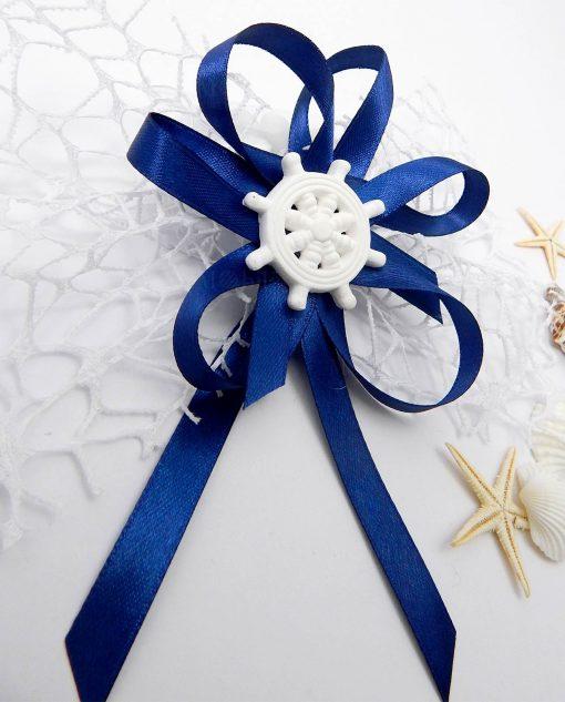 segnaposto con timoe in gesso bianco rete e nastri blu