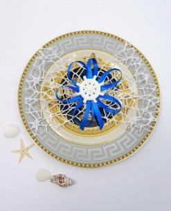 segnaposto tema mare con timone in gesso e rete bianca