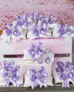 bomboniera farfalla cristallo tufano su sacchetto bustina doppi fiocchi bianchi e viola 1