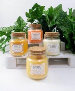 candele aromatizzate in barattolo di vetro con tappo in sughero