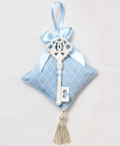 chiave porcellana con cuscino azzurro per bomboniere ad emozioni