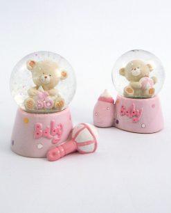 palla di neve rosa con soggetti assortiti per bomboniere battesimo bimba