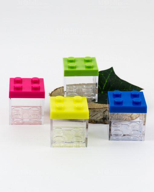 scatolina portaconfetti trasparente lego con tappo rosa giallo verde e blu