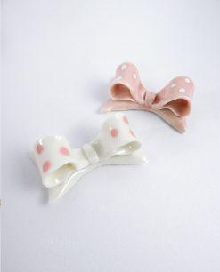 Calamita fiocco a pois bianco e rosa assortito