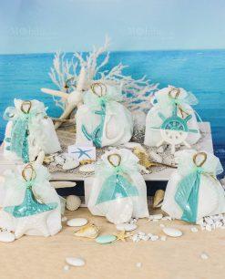 bomboniera pendenti bianchi e tiffany soggetti marini assortiti su sacchetto bianco con cordoncino linea summer ad emozioni