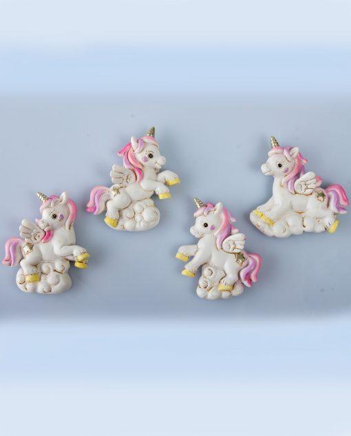 calamita unicorno rosa e oro