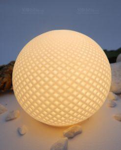 lampada sfera led accesa porcellana