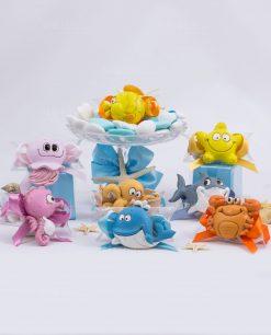 magnete animali marini assortiti su tubicino portaconfetti con nastro