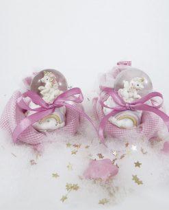 unicorno dentro palla di neve e sacchetto rosa
