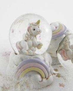 unicorno dentro palla di vetro con arcobaleno