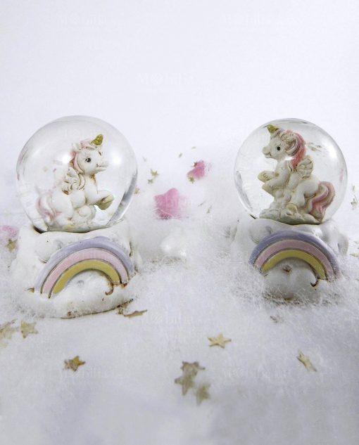 unicorno dentro palla ed arcobaleno viola rosa e giallo
