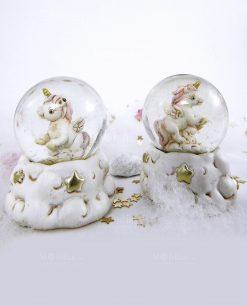 unicorno rosa dentro palla con stelle dorate