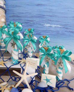 bomboniera tubo vetro con confetti nastri e ciondolo stella marina argentato
