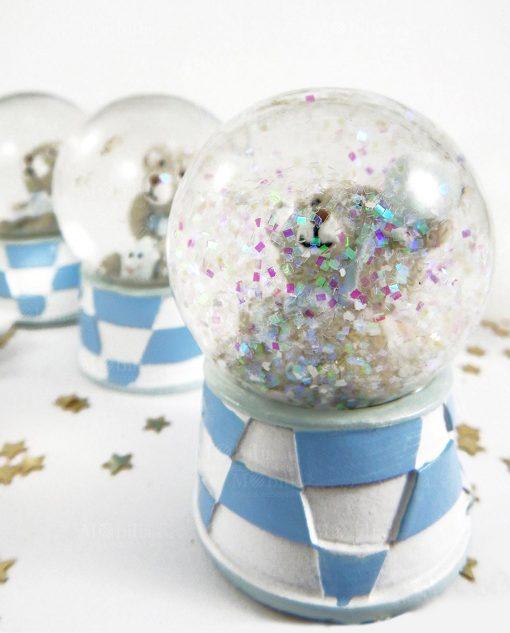 palla di neve con orsetto e stelle volanti glitter