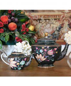 teiera diffusore decoro pavone blu con fiore bianco baci milano collezione tea time