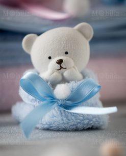 orsetto piccolo con sacchetto azzurro linea coccole polari foto ambientata ad emozioni