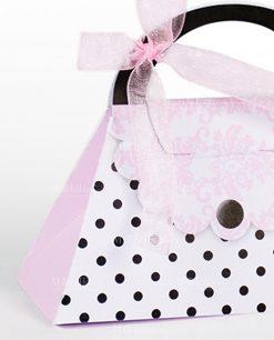 scatola a forma di borsetta con pois neri