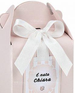 scatola scrigno rosa con nastro bianco