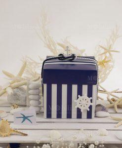 scatola spacco a righe blu e bianca con tubicino con confetti con bigliettino stella marina
