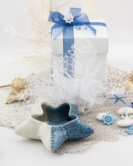 bomboniera svuotatasche conchiglia con sacchetto scatola e nastri linea oceano ad emozioni