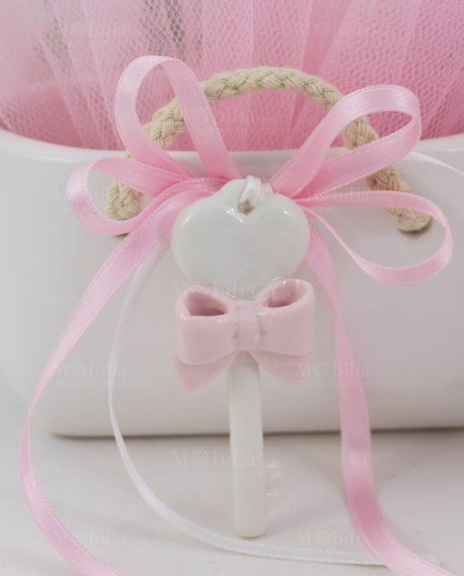 chiave bianca porcellana con nastri rosa linfinito