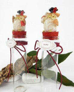 provetta vetro con tappo sughero rosso gufetto con tocco pergamena e libro