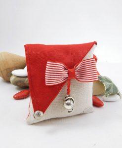 sacchetto portaconfetti con papillon rosso a righe bianche con ciondolo mappamondo cherry and peach