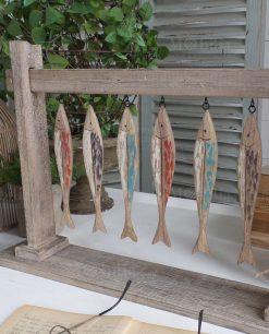 scultura legno con pesci modello fishes orchidea milano